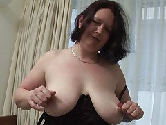 She takes off her clothes and massages her boobs while looking at the camera. Daisy knows that we are watching her and that makes this whore horny! Now she's almost naked, keeping only those semitransparent black panties that cover her big booty. Curious if she will take them of and fuck her pussy real hard?